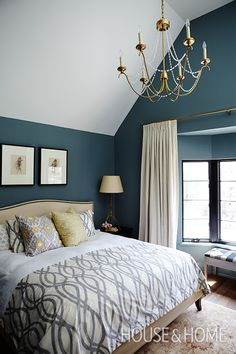 Benjamin Moore's Templeton Gray reads as blue in this bedroom, giving the space a cozy, cocooning feel. | Photographer: Angus Fergusson | Designer: Olivia Botrie