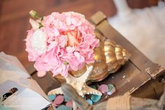 Seashell and flower from Pastel Mermaid Birthday Party at Kara's Party Ideas. See the ocean of details at karaspartyideas.com!