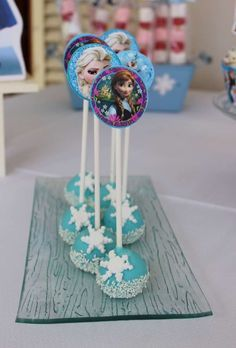 Elsa and Anna cake pops at a Frozen birthday party! See more party planning ideas at CatchMyParty.com!