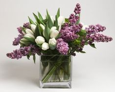 Purple and white lilacs wedding table centerpiece - didn't think I'd like the tulips but it's pretty