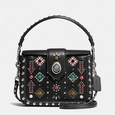 Coach All Over Western Rivets Page Crossbody ($550) ❤ liked on Polyvore featuring bags, handbags, shoulder bags, leather shoulder handbags, cell phone crossbody, western crossbody purse, crossbody handbags and leather shoulder bag
