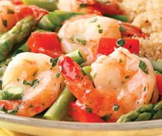 Lemon-Garlic Shrimp and Vegetables Here's a healthy twist on shrimp scampi. We left out the butter and loaded the dish up with red peppers and asparagus for a refreshing spring meal. Serve with quinoa. Calories - 227 Carbohydrates - 14g Saturated Fat - 1g Protein - 28g Sodium - 618mg Dietary Fiber - 4g