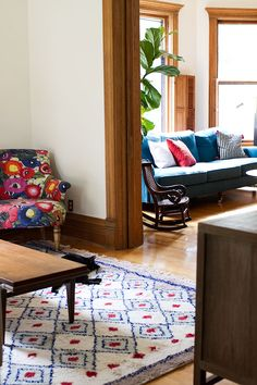 Love the rug and the blue sofa