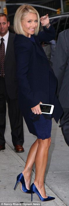 With new phone in hand: The morning talk show host was seen leaving the studio after the t...