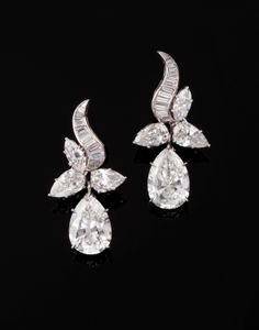 Drop pendant earrings of pear-shaped, baguette and navette diamonds in platinum, circa 1950
