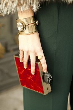 Vogue España street style: Bracelet by Anton Heunis, clutch and ring inherited from her mother. Photo by Azahara Fernández