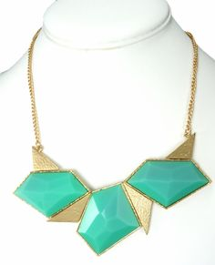Green art deco triangle necklace in a gold setting.