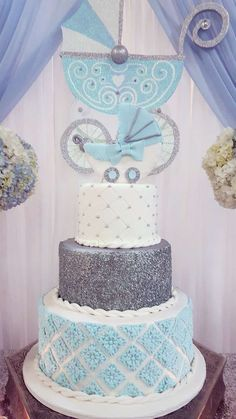 Blue and silver cake at a glam baby shower party! See more party planning ideas at CatchMyParty.com!
