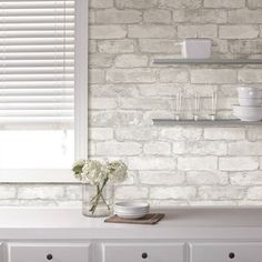 Fashion your own brick wall in a matter of minutes with this chic peel and stick wallpaper. Treated to a beautiful rustic finish, this grey and white faux brick design brings a dimensional look to walls that are both authentic and grand. Kitchen Wallpaper, White Brick Backsplash, White Brick, Brick Kitchen, Peel And Stick Wallpaper, White Brick Walls, Brick Design, Temporary Wallpaper, Nuwallpaper