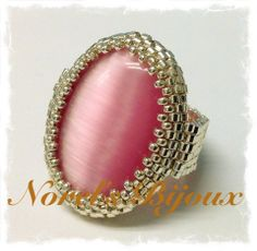 Peyote Beaded Ring. Pink Cat's Eye Cabochon surrounded by Delicas and 15/0 Miyukis in Galvanized Silver.