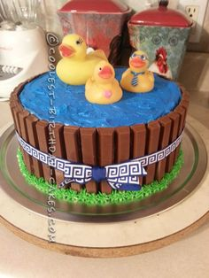 I baked two round cakes (chocolate! Then stacked them and iced with homemade buttercream( again, chocolate! I colored some with blue gel co Ducky Baby Showers, Rubber Ducky Baby Shower, Baby Shower Duck, Baby Shower Cakes, Pool Birthday Cakes, Pool Party Cakes, Pool Cake, Birthday Ideas, Diy Birthday