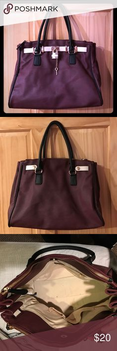 Burgundy Aldo purse Great condition! Some light signs of wear inside, but otherwise in like new condition, burgundy bag with black, tan and gold gold accents. Interior pockets for organization. Aldo Bags Totes