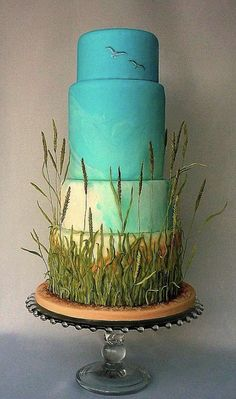 Cake with grass decor made from frosting - looks like a marsh! | Green Grass Wedding Reception Details For Spring