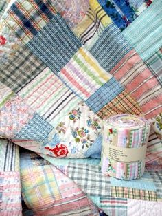 a soft palette of pinks, blue, grey some pink florals with faded yellows in stripes and checks