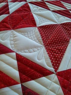 When asked to quilt two red and white quilts for an upcoming AQS book, I was honored. When given the selection of quilt tops to choose fro...