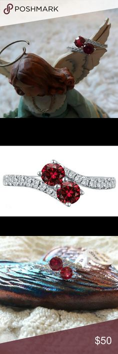 NWT 2.5 CTTW Ruby/White Topaz & Sterl. Silver Ring NWT. Sterling Silver ring plated with rhodium. Has two 5mm genuine ruby gemstones, surrounded by 16 white topaz gemstones at 2mm each. All gemstones are AAA quality and ideal cut. Size 7. Jewelry Rings