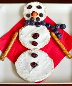 Love!  Healthy Snowman snack (using bagel, cream cheese, baby carrot, blueberries, raisins & chocolate chips!)