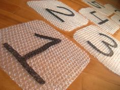 bubble wrap hop scotch - my boys would LOVE this (and so would I!)