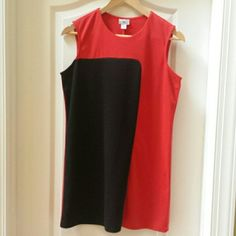 Retro style color block tunic/dress Black and red color block design.   For shorter beauties, could be worn as a dress.  For us taller beauties, best as a tunic with leggings.  Polyester and spandex.   Minor piling as seen in pic 2 that's not noticeable when worn.  30 inches long. Worthington Dresses Mini