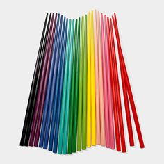 MoMA - Rainbow Chopsticks Lacquered in bright colors, this set includes twelve pairs of reusable wooden Rainbow Chopsticks. Great for parties, the different colors help guests remember which chopsticks are theirs. Hand-wash only. Moma Store, Wooden Rainbow, Rainbow Connection, Over The Rainbow, Rainbow Roll, Rainbow Colors, Rainbow Stuff, Bright Colors, Rainbow Things