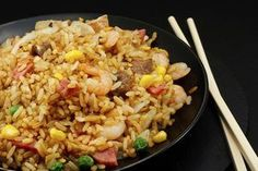 How to Make Fried Rice Like a Japanese Steakhouse's Version...Japanese fried rice (cha-han) on matte black round plate.