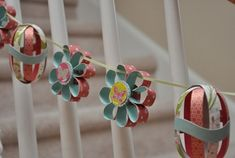 http://www.happyclippings.com/2011/03/diy-paper-flower-easter-egg-garland.html