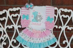Sparkling Winter ONEderland outfit in blue, pink, and silver! Listing includes: Applique bodysuit/shirt Ruffle skirt Hair bow Leg warmers See other combinations of the items shown in the birthday section of our shop: First Birthday Outfit Girl, Baby First Birthday, Girl Birthday, Birthday Ideas, Elephant Birthday, Winter Onederland, Pink Stripes, Applique Designs, Leg Warmers