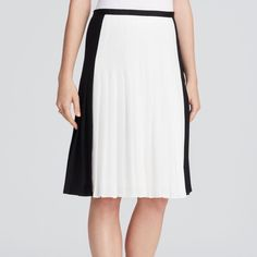 """✨HP✨🆕 NWT Vince Two Tone Pleated Skirt 🌟Weekend Warrior HP🌟NWT Black and white bi-color blocking sharpens the look of the crisp pleating. Ribbon trimmed waist, concealed zipper. Fully lined. Waist 14"""" flat, Length 23.25"""".  100% poly, dry clean. Vince Skirts"""