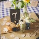 Table number and centerpiece arrangement. #heart #shabbychic #wedding