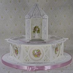 - Royal icing paneled cake with royal icing gazebo topper