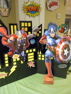 Cardboard CityScape, characters standing by dial rod and base, Avenger decorations hanging from ceiling. Avenger Party, Avengers Birthday, Booth Ideas, Photo Booth, Thor, Birthday Ideas, Spiderman, Birthdays, Parties