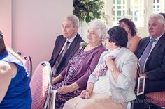 Wedding guests at Highcliffe Castle Wintergarden wedding ceremony.Photography by one thousand words wedding photographers