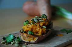 Fresh and Fierce Everyday Crunch Topping on a Baked Sweet Potato.