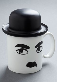 This would be great for steeping tea & then keeping it warm while reading a book or some such thing (though I'd prefer a Buster Keaton version). Hats Entertainment Mug, #ModCloth