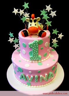 ok a version of this might be perfect. Giraffe if Lil's favorite favorite but it's pink. I could do thids with a pink giraffe and something other then stars sticking out and plain pink icing with green fondant dots...?