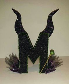 "One Female Villain Maleficent Character paper mache Letter ""M"". Birthday decor or can be used as a cake topper! Maleficent Party, Disney Halloween, Halloween Party, Birthday Decorations, Halloween Decorations, Villains Party, Female Villains, 6th Birthday Parties, Disney Crafts"