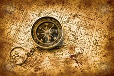 http://watermarked.cutcaster.com/cutcaster-photo-100347677-Compass-and-map.jpg