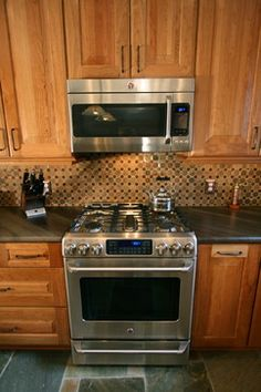 Classic Craftsman Kitchen  The Craftsman style can be done a couple of ways. There is the purist approach which is what these homeowners were looking to create with the flooring, cabinets and tile.