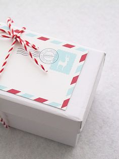 Printable postcard gift tags.  So cute!  Love the red and white twine tying it together.