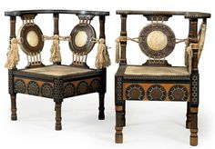 CARLO BUGATTI (1856-1940) PAIR OF CORNER CHAIRS, CIRCA 1902, polished and stained walnut, vellum seat and back, copper, brass, pewter, silk tassels, 28 in. (71.1 cm.) high (2)  |  SOLD $16,352 Christie's London, April 21, 2010