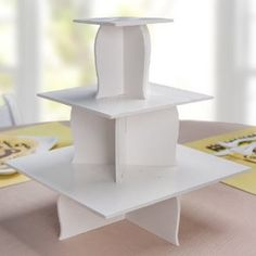 Uniquely designed cupcake stand will wow any of your party guests. The curved edge and neutral white color is perfect for your buffet food table. Stand is made out of sturdy white foam board - one time use.