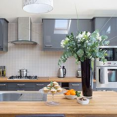 grey gloss cabinets and smaller grey tiles http://www.housetohome.co.uk/kitchen/picture/kitchen-with-grey-hi-gloss-cabinetry