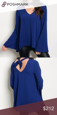 FLARED SLEEVED VNECK TOP NEW!   NAVY BLUE FLARED SLEEVED TOP WITH V NECKLINE WITH CHOKER DETAIL AND TIE DETAIL IN BACK. TUNIC FIT. TRUE TO SIZE FOR STYLE   96% POLYESTER 4% SPANDEX HVHOUSEWIFE Tops Blouses