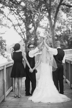 Bride and groom with best man and maid of honor