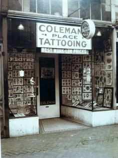 "1937 photo of ""Cap"" Coleman's tattoo shop on Main Street in downtown Norfolk Virginia. #VanishingTattoo #VintageTattoos #TattooHistory"