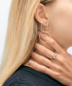 Moving away from the simple, traditional design, we've put together an edit of our favorite attention-grabbing hoop earrings with a twist to complement any party look this holiday.