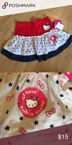 NWT Hello Kitty skort size 4 Brand-new with tags. Size 4 skort made by Sanrio. Red white and blue, with hello Kitty in glitter on the hip. Built-in shorts. Sanrio Bottoms Skorts