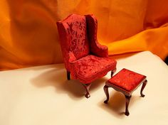 with dining room chair that has these type of legs cane make a cover like this and some sides and make an ottoman out of the other legs :)