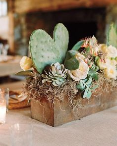 Window-box-like centerpieces at a ranch wedding in California brimmed with prick. Window-box-like centerpieces at a ranch wedding in California brimmed with prickly pear cactus, echeveria, Aeoniums, gar. Cactus Centerpiece, Succulent Wedding Centerpieces, Cactus Wedding, Rustic Wedding Centerpieces, Wedding Flowers, Wedding Decorations, Centerpiece Ideas, Salmon Wedding, Plant Centerpieces