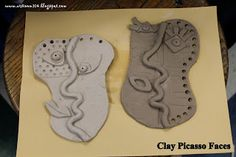 Clay Picasso faces. Finish with wire/bead/pipecleaner hair